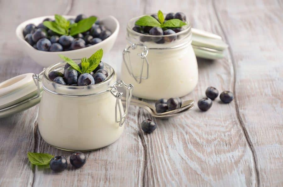 jars of Greek Yogurt with fruit on the table